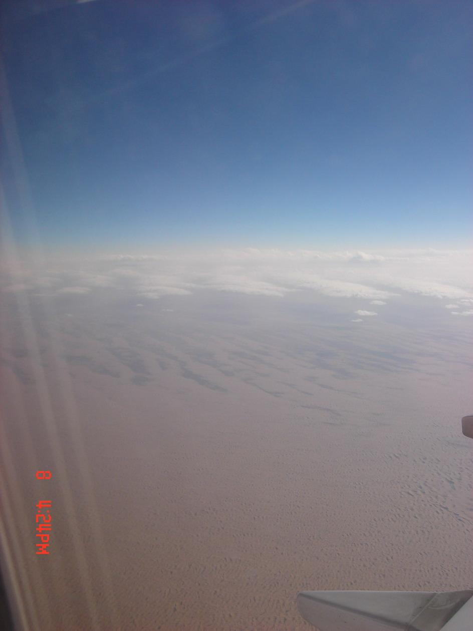 网上的很多游记里有飞机上看雪山的描写和照片,但是所有的文字和图片
